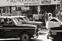 Taxi's on a street in Mumbai, India