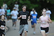 Runners race in the Doublke Decker 5K race on Sunday, April 25, 2010 in Oxford, Miss.