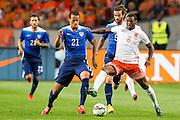 AMSTERDAM - Nederland - USA , Amsterdam ArenA , Voetbal , oefeninterland , 05-06-2015 , Nederlands elftal speler Georginio Wijnaldum (r) in duel met Verenigde staten speler Timmy Chandler (l)