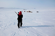 Canadian Inuit Rangers poses with his old Lee Enfield .303 rifle near his camp on Cornwallis Island, Nunavut during Nunalivut 2012 sovereignty exercise by Canadian Forces in arctic Canada. April 2012.