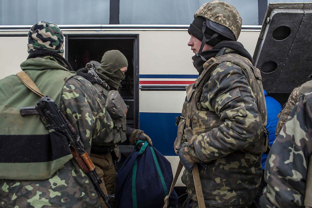 ARTEMIVSK, UKRAINE - FEBRUARY 19: Ukrainian soldiers from a unit based in Zaporizhia gather their belongings after withdrawing from Debaltseve on February 19, 2015 in Artemivsk, Ukraine. Ukrainian forces started withdrawing from the strategic and hard-fought town of Debaltseve yesterday being effectively surrounded by pro-Russian rebels. (Photo by Brendan Hoffman/Getty Images) *** Local Caption ***