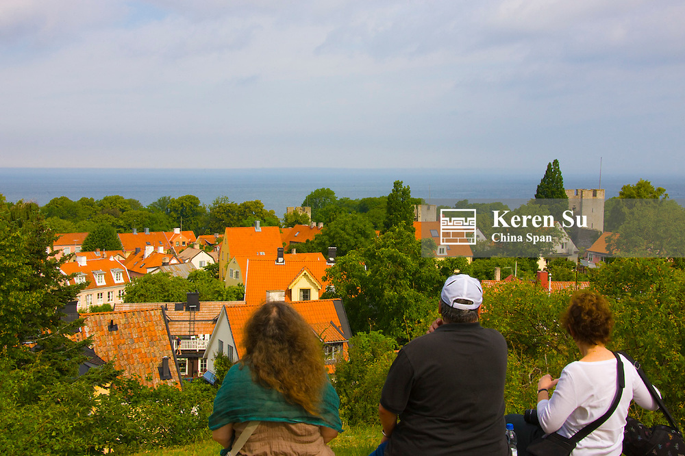 Travelers watch the red roofs, Visby, Gotland Island, Sweden