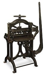 Vintage cast iron printing press, isolated on white with clipping path