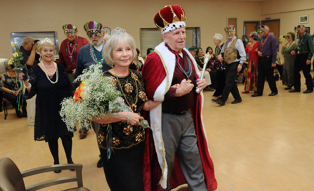 jt030217b/a sec/jim thompson/King Richard Binkowski and Queen Della Binkowski do a stroll with former kings and queens at the Mardi Gras celebration at the Meadowlark Senior Center. Members of the Native New Mexico Club celebrated Mardi Gras at the Senior Center Thursday afternoon with food and music.   Thursday March 02, 2017. (Jim Thompson/Albuquerque Journal)