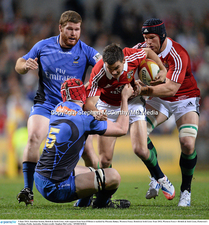 5 June 2013; Jonathan Sexton, British & Irish Lions, with support from Sean O'Brien is tackled by Phoenix Battye, Western Force. British & Irish Lions Tour 2013, Western Force v British & Irish Lions, Patterson's Stadium, Perth, Australia. Picture credit: Stephen McCarthy / SPORTSFILE
