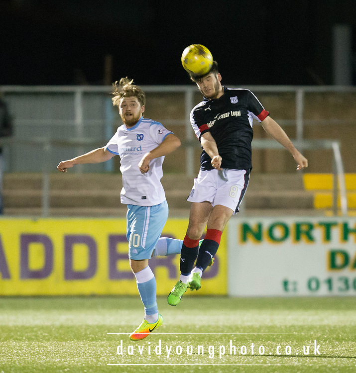 Dundee's Daniel Higgins heads clear from Forfar's Aiden Malone  - Forfar Athletic v Dundee, Martyn Fotheringham testimonial at Station Park, Forfar.Photo: David Young<br /> <br />  - &copy; David Young - www.davidyoungphoto.co.uk - email: davidyoungphoto@gmail.com