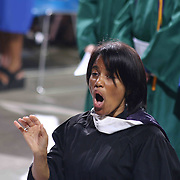 Thomas McKean Choir Director Chrystal Haas leads performance during McKean 49th commencement exercises Saturday, June 06, 2015, at The Bob Carpenter Sports Convocation Center in Newark, Delaware.