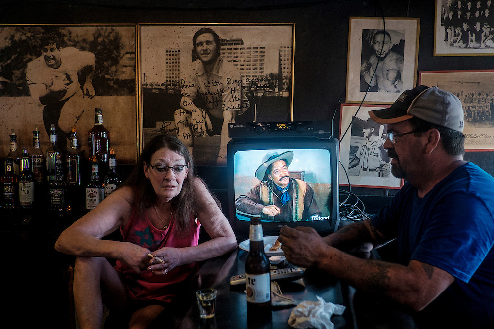 Bartender, Lisa Nicely, talks with West Aliquippa resident Chuck Forrester in Mahoney's West bar in West Aliquippa, Pennsylvania, USA on May 8, 2015. Mahoneys, in operation in West Aliquippa for 40 years, closed in 2016 when its owner became ill and unable to continue the business.