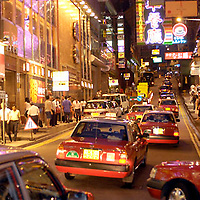 Taxis, cars. lights, stores, noise,  signs and movement Kowloon Island &amp;#xD;Hong Kong China Asia ( movie cinema theather famous actors actress star hand&amp;#xD;&copy; KIKE CALVO - V&amp;W&amp;#xD;metropolitan British colony Chinese kowloon urban city cosmopolitan asian shooping paradise technology business architecture buildings landmark<br />