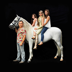 Portrait of Kanat and Tatiana Tchalabaeva with their kids Veronica and Angelica. The parents lead The Thundering Cossack Warriors in the show.<br /> <br /> Ringling Bros. and Barnum &amp; Bailey Circus started in 1919 when the circus created by James Anthony Bailey and P. T. Barnum merged with the Ringling Brothers Circus. Currently, the circus maintains two circus train-based shows, the Blue Tour and the Red Tour, as well as the truck-based Gold Tour. Each train is a mile long with roughly 60 cars: 40 passenger cars and 20 freight. Each train presents a different &quot;edition&quot; of the show, using a numbering scheme that dates back to circus origins in 1871 &mdash; the first year of P.T. Barnum's show.