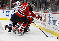 Feb 26, 2009; Newark, NJ, USA; New Jersey Devils center Travis Zajac (19) skates with the puck during the second period at the Prudential Center.