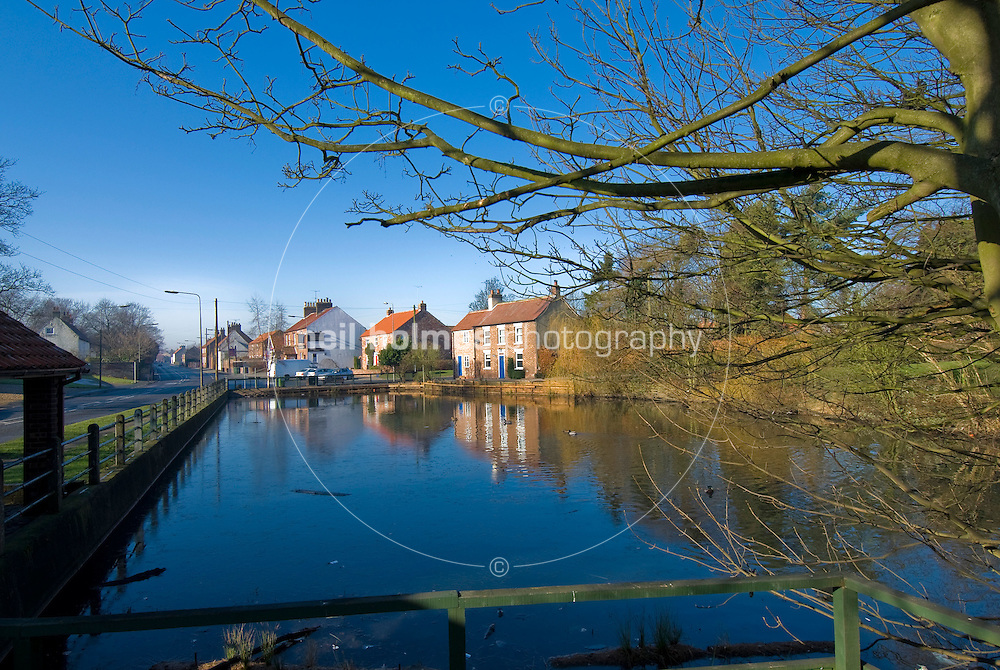 Village Pond and the Old Smithy holiday cottage, Wetwang Village East Yorkshire