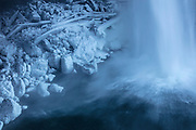 Spray from Snoqualmie Falls, located near Snoqualmie, Washington, freezes to rocks and logs at the base of the waterfall on a frigid 17°F (-8°C) morning.