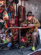 Man repairing carpet at the Jaffa flea-market