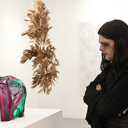 London, UK - 11 October 2012: a visitor looks at a sculpture during the Frieze Art Fair 2012, London's big annual art fair that takes place in Regent's Park. It sells the works by more than 1,000 of the world's leading artists, represented by some 170 international galleries.