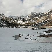 Morning at Lake Sabrina in the Sierra Nevada Mountains.  The high altitude of the lake results in cold temperatures even in May when the lake is still frozen in many parts.    Lake Sabrina is off of Hwy 168, west of Bishop, California.  The lake is a popular desination for fishing and hiking.