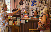 vicki Velasquez, owner of The Painted Lizard in Yarmell, Arizona, talks with customers.
