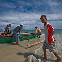 A canoe is launched off the coast of Teku in Central Sulawesi