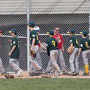04/14/12 Newark Del. Phillies and A's players meet at home plate after a A's 7-2 Canal L.L. League victory over the phillies Saturday, April. 14, 2012 at Canal L.L. Complex in Bear Delaware...Special to The News Journal/SAQUAN STIMPSON