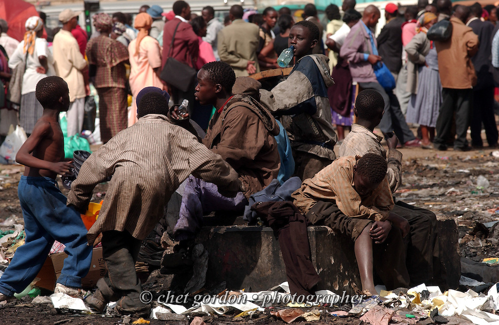 Young street boys gather on a non-working fountain near a bus station in downtown Nairobi, Kenya in February 2004.