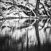 Winter reflects on the water on Spring River in Missouri.