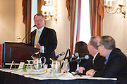Greg David, Director of the Business and Economics Reporting Program at the CUNY Graduate School of Journalism moderates the panel discussion at the Manhattan Chamber of Commerce Annual Economic Outlook Breakfast was held at the New York Athletic Club in New York on April 4, 2011. The breakfast was sponsored by Wells Fargo.