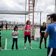 Instructor Zack Bodinger briefs students on their next trick at Trapeze School New York during the June 4th morning class. The two hour beginner session taught the nine students in attendance the basics of flying trapeze -- including knee hangs and backwards somersaults -- in their facility on the roof of Pier 40...CREDIT: Daniella Zalcman for The Wall Street Journal.SLUG: NYMETROMONEY_Trapeze