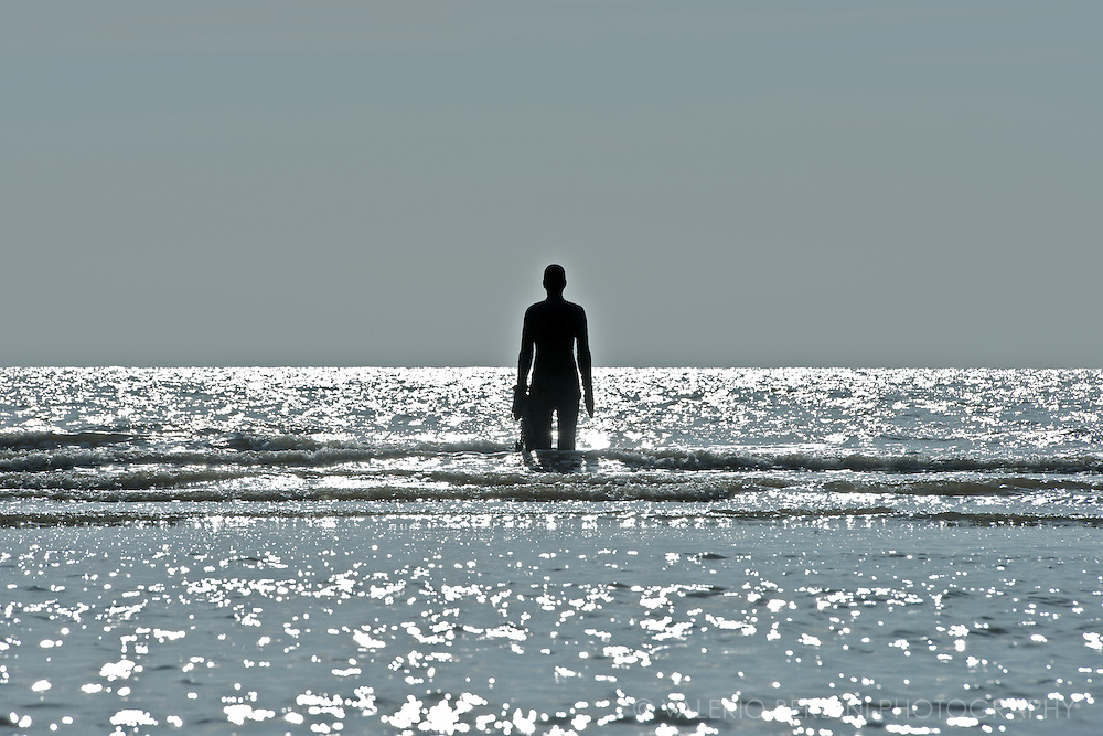 Sinking man, sinking sand, sinking sun..@ Another Place. Antony Gormley. Crosby beach, Liverpool, Merseyside. England