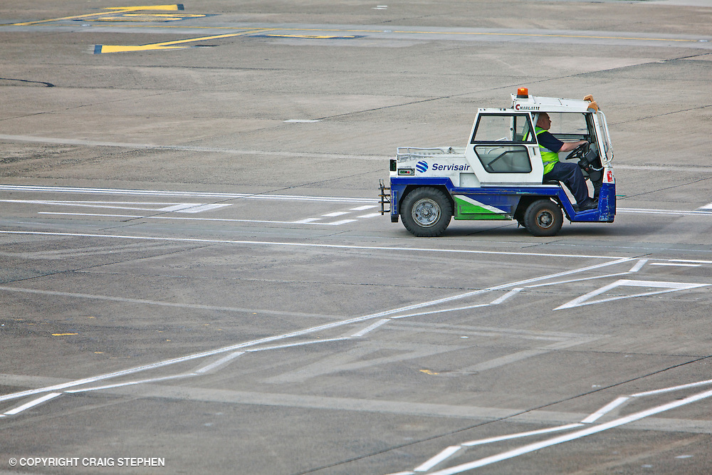 Small Servisair airport support vehicle on the tarmac