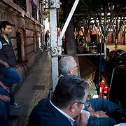 A view behind stage of Aleka Papariga's speech for the Greek communist party (KKE) in Athens, Greece. Image © Angelos Giotopoulos/Falcon Photo Agency