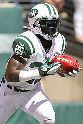 Sept 9, 2012; East Rutherford, NJ, USA; New York Jets running back Joe McKnight (25) returns the opening kickoff during the first half of their game against the Buffalo Bills at MetLIfe Stadium.