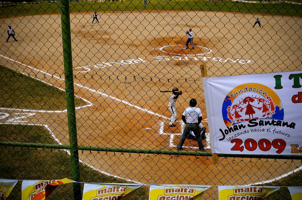 Fans chalked Johan Santana's name on the field where he grew up playing baseball in Tovar, Venezuela during their Little League championship game Saturday, Dec. 12, 2009. Before throwing the opening pitch of the game, Santana surprised every team in the little league with new equipment.