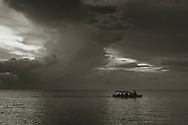 A water taxi ferries passengers to the main town, Apia, Samoa.