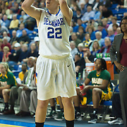 Delaware Guard Lauren Carra (22) attempts a long range shot in the first half of an NCAA college basketball game against George Mason Thursday, Feb. 23, 2012, at the Bob Carpenter Center in Newark, Del. (AP Photo/Saquan Stimpson)