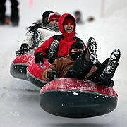 Friends (From front to back of line) William Neidig, 27; Ruby Hernandez, 24; Danett Hernandez, 20 and Raul Hernandez, 21 go over a jump on tubes at the Coca-Coca Tubing Hill at Copper Mountain Ski Resort in Colorado Tuesday December 20, 2005. The attraction costs $18 for adults and $13 for kids for a one hour session. With all the snow that has fallen recently the mountain towns have become a winter wonderland and playground.They said they came up for the day to have fun because Raul is headed to Iraq soon. They came up tubing for a day last year also..(MARC PISCOTTY/ © 2005)