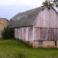 A collection of Barns that still can be seen while traveling the countryside in  the beautiful State of Wisconsin.<br /> Monroe County- Barn and Silo with no top. Town of Portland, Hwy 33.