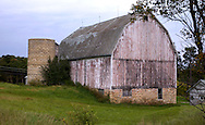A collection of Barns that still can be seen while traveling the countryside in  the beautiful State of Wisconsin.<br /> Monroe County- Barn and Silo with no top. Town of Portland, Hwy 33. Barns from around the State of Wisconsin.