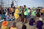 Volunteers help a sick priest during a mass celebrated by Pope Benedict XVI at the base of Cuatro Vientos, eight kilometres (five miles) southwest of Madrid on August 21, 2011. The next World Youth Day festival of the Roman Catholic Church will be held in Rio de Janeiro in 2013, Pope Benedict XVI announced Sunday in Madrid