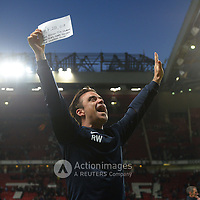 Football-England v Rest of the World-Socceraid-Old Trafford-08/06/2014-Pictures by Paul Currie-KEEP-England's Robbie Williams celebrates raising 4 million at the Socceraid event held at Old Trafford