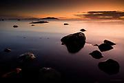 UK; British Isles; Wales; Anglesey; Ynys Mon; Church Bay; Porth Swtan; Irish Sea; sea; water; sunset; shore; shoreline; boulders; dusk; tranquil; evening; Coast; coastline; tide; Holyhead, Holyhead Mountain,