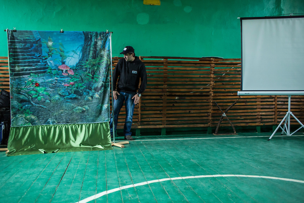 An employee of the Swiss Foundation on Mine Action prepares for a mine awareness training at School #21 on Tuesday, December 15, 2015 in Scherbynivka, Ukraine.
