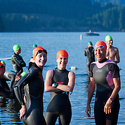 Mariko Yokote, Pam Fairchild, Melanie Haliburton and unidentified athlete await the men's start.  Best in the West Triathlon.  Half Ironman Triathlon at Foster Lake on 10 September 2011, Sweet Home, Oregon.
