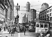 Opening Day of Bay Bridge, Showing Long Line of Streetcars at Market and First Streets | January 17, 1939