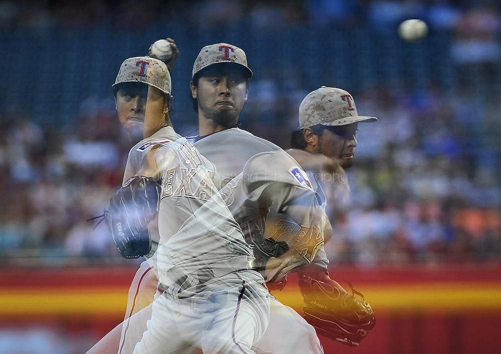 PHOENIX, AZ - MAY 27:  Pitcher Yu Darvish #11 of the Texas Rangers pitches against the Arizona Diamondbacks in the second inning of an interleagure game at Chase Field on May 27, 2013 in Phoenix, Arizona.  (Photo by Jennifer Stewart/Getty Images)