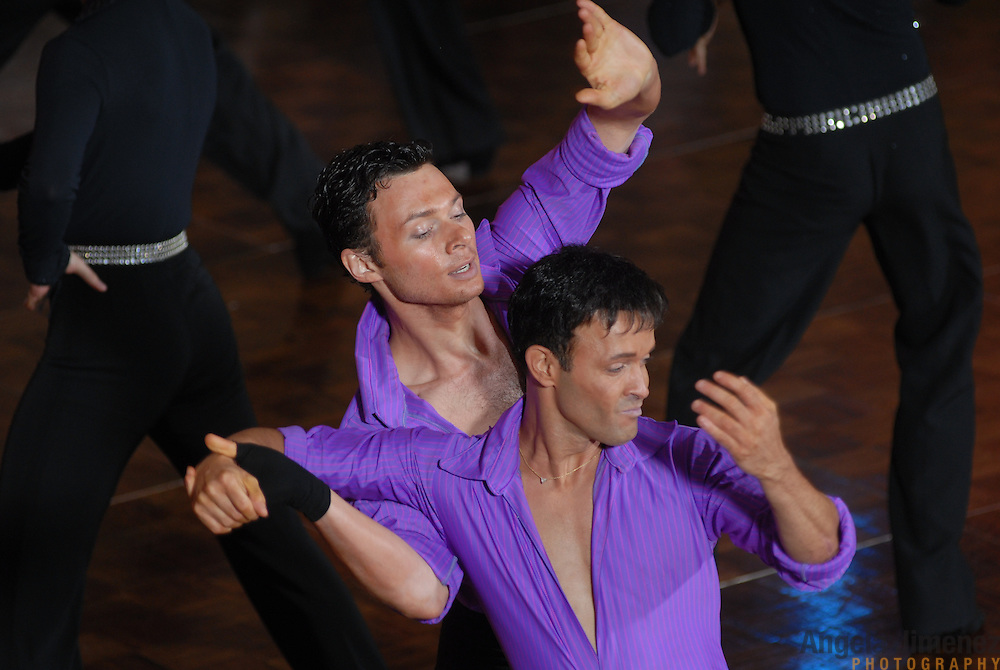 Gay ballroom dancers Andre Nadko, left, and Jorge Guzman, both of New York City, rehearse before they compete during the Dancesport ballroom dancing competition at the Hilton Hotel and Towers in downtown Chicago during Gay Games VII on July 20, 2006. ..Over 12,000 gay and lesbian athletes from 60 countries are in Chicago competing in 30 sports during the Games from July 15 through 22, 2006. ..Over 50,000 athletes have competed in the quadrennial Games since they were founded by Dr. Tom Wadell, a 1968 Olympic decathlete, and a group of friends in San Francisco in 1982, with the goal of using athletics to promote community building and social change. ..The Gay Games resemble the Olympics in structure, but the spirit is one of inclusion, rather than exclusivity. There are no qualifying events or minimum or maximum requirements...The Games have been held in Vancouver (1990), New York (1994), Amsterdam (1998), and Sydney (2002). .