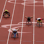 LONDON 2012 PARALYMPIC GAMES.. Pic shows wheelchair athletes racing  at the Olympic Stadium at the London Paralympic Games,London.