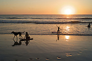 At sunset, the local crowd along with tourists gather in front of Lolas Restaurant in Playa Avellana. B1276