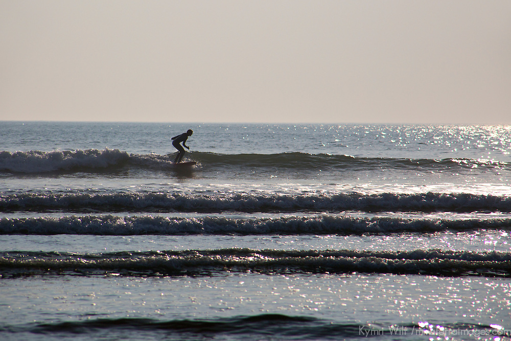 Europe, United Kingdom, Wales. Surfer at Newgale Beach in Pembrokeshire.