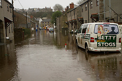 © Licensed to London News Pictures. 22/12/2012. Helston, UK. Cars surrounded by flood water on St Johns Road in Helston caused by the River Cober bursting its banks over night after heavy rain across the South West. The Environment Agency issued a Severe flood warning for the River Cober. Photo credit : Ashley Hugo/LNP