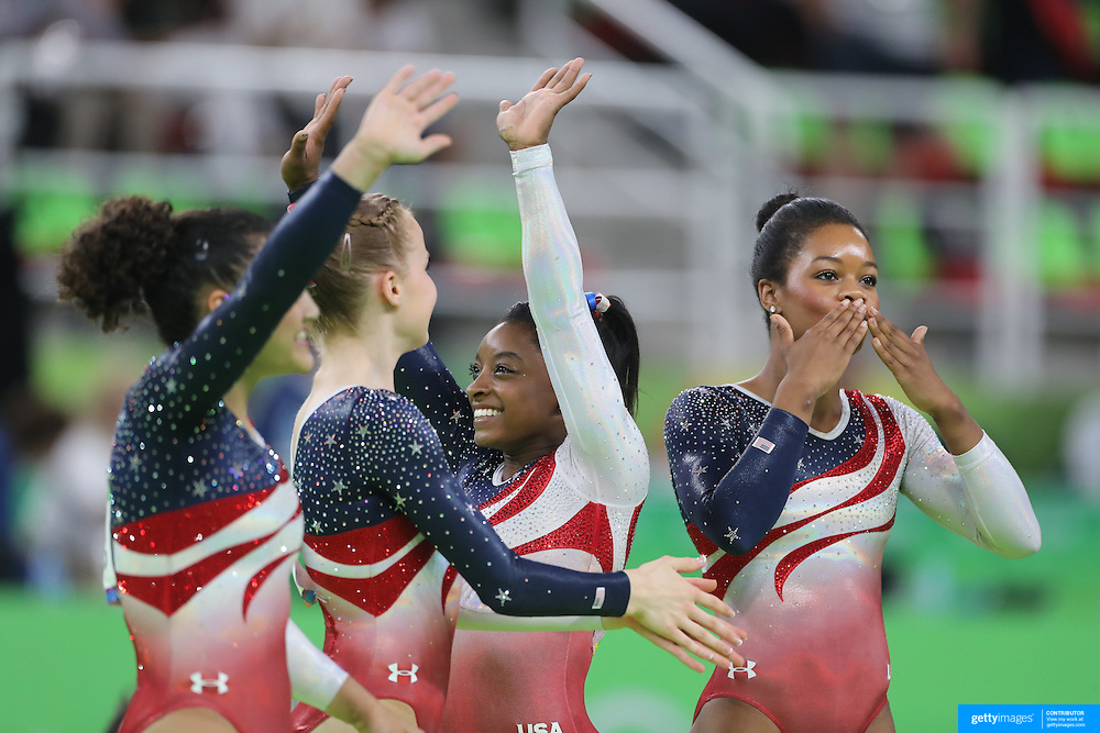 Gymnastics - Olympics: Day 4   The United States team of Alexandra Raisman, Madison Kocian, Lauren Hernandez, Gabrielle Douglas and Simone Biles celebrate after the United States team won the Artistic Gymnastics Women's Team Final at the Rio Olympic Arena on August 9, 2016 in Rio de Janeiro, Brazil. (Photo by Tim Clayton/Corbis via Getty Images)